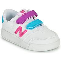 Παπούτσια Κορίτσι Χαμηλά Sneakers New Balance COURT Άσπρο / Ροζ